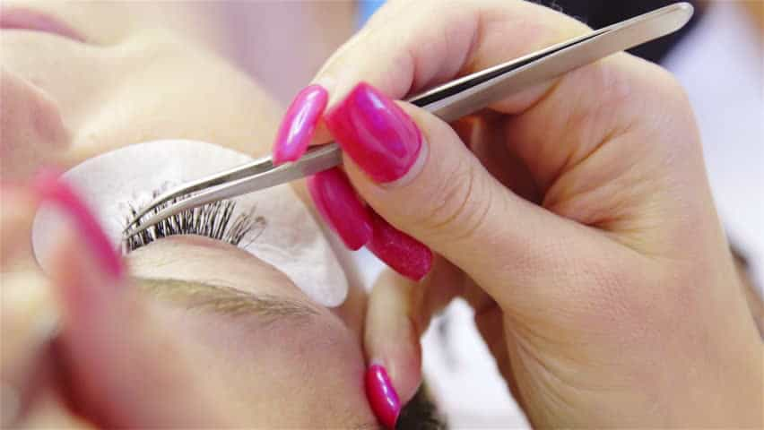 Use a tweezer instead of your acrylic nails